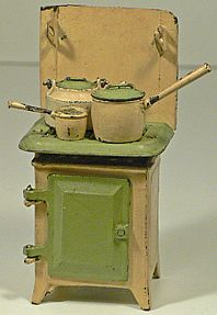Antique child's stove with accessories.