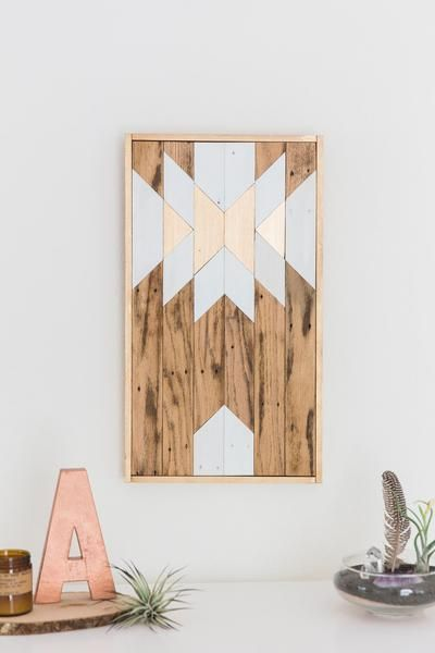 This piece would look amazing hanging on a wall! This southwestern style reclaimed wood wall art, a mix of earthy materials and contemporary shapes, adds a hint