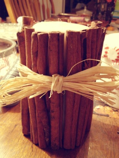 Candle encased in cinnamon sticks