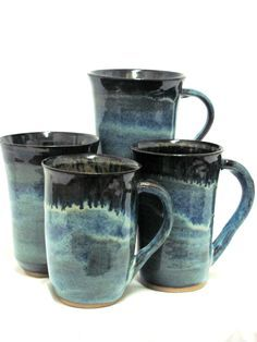 Wheel thrown stoneware coffee mugs glazed with Potters Choice Blue Rutile glaze and fired to cone 5 with a 30 minute hold in an electric kiln. Created by Ann Augustin Pottery, Frisco, TX.