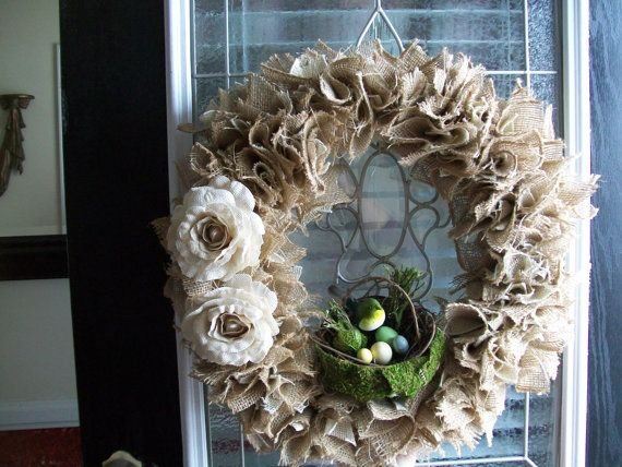 It is a straw base wreath covered with Cream Burlap and Brown Burlap flowers.  This wreath is beautiful and it has two Cream color Burlap