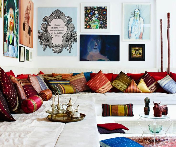 Beautiful Pillows Covering A Large Sectional And Art Ethnic Living RoomLiving