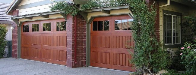14 best images about faux wood garage doors fiberglass for Wood veneer garage doors