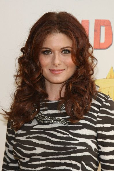 Debra Messing Long Curls - Debra Messing arrived at the opening night of 'Peter and the Starcatcher' on Broadway wearing her hair in shiny voluminous curls.