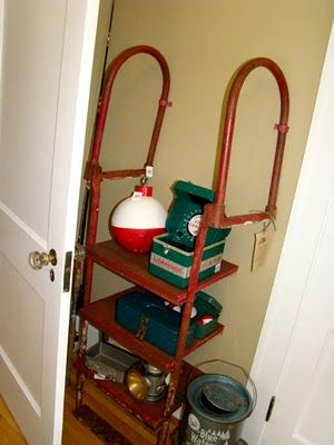 Old dock ladder wall shelves (the big bobber is made with a bowling ball!) and the fun light fixture!