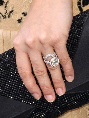 Carrie Underwood's yellow diamond engagement and wedding rings.