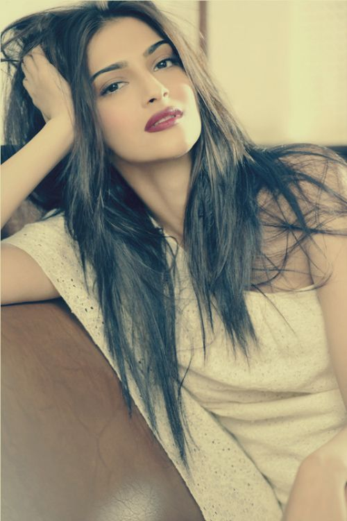 Sonam Kapoor. Bold lips and straight hair.