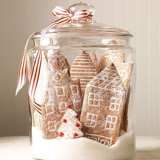 Edible Christmas village made with cookie buildings and sugar snow