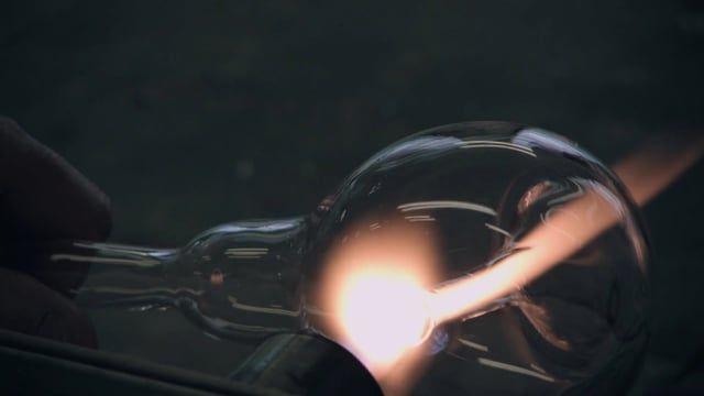 """Edison's Nightmare. designed by Harry Thaler, 2012 for Davide Groppi. """"L'abbiamo appesa al muro"""". Il vetro soffiato a mano rende l'oggetto unico, e la luce irripetibile.  Una lampada gestuale, carica di ironia e nostalgia per la lampadina ad incandescenza ormai in disuso.  """"We hung it on the wall"""".  The blown glass made by hand gives it a special, unique quality. It's like an ironic wave of the hand, full of nostalgia for the old incandescent lamps no one uses anymore."""
