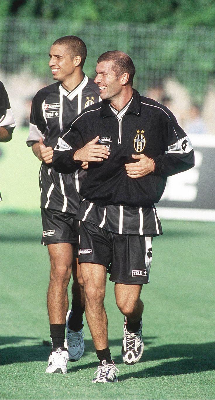 David Trezeguet and Zinedine Zidane share a joke during a Juve training session.