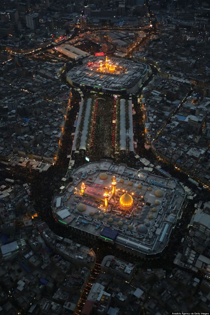 KARBALA, IRAQ - DECEMBER 13: Aerial view of Imam Hussein's shrine and Abbas ibn Ali's shrine are seen as Shi'ite people gather during the Arba'een ceremony in the holy city of Karbala, southern Iraq on December 13, 2014. Hundreds of Shiite worshippers attend religious festival ceremonies in Karbala on the anniversary of the 40th day after the martyrdom of Imam Hussein, grandson of Prophet Mohammad who was killed in the Battle of Karbala in 681AD.