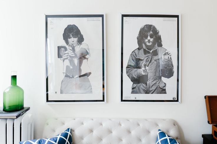 These graphic framed prints keep the West Elm tufted Elton settee from feeling too traditional. The framed targets are from Speedwell Targets, inside IKEA's RIBBA frames.