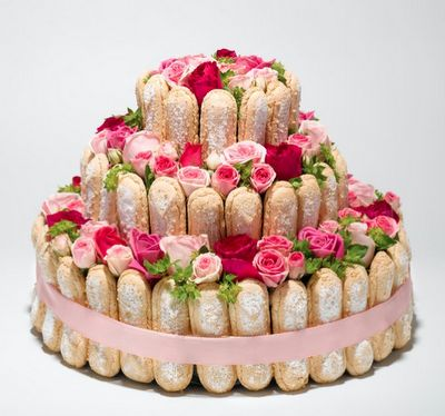Beautiful centerpiece from rose store in Paris called Au Nom de la Rose. Ladyfingers, pink ribbon and fresh roses. Just to look at, can't eat it!