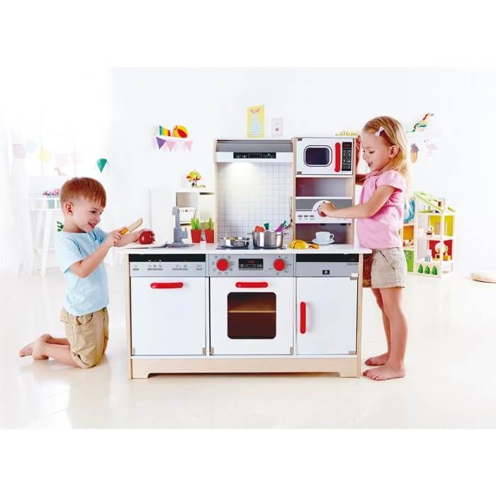 """Children will love this multi-functional, All-in-1-Kitchen and its array of charming appliances and features, including a controllable range hood lamp and authentic microwave """"ding"""""""