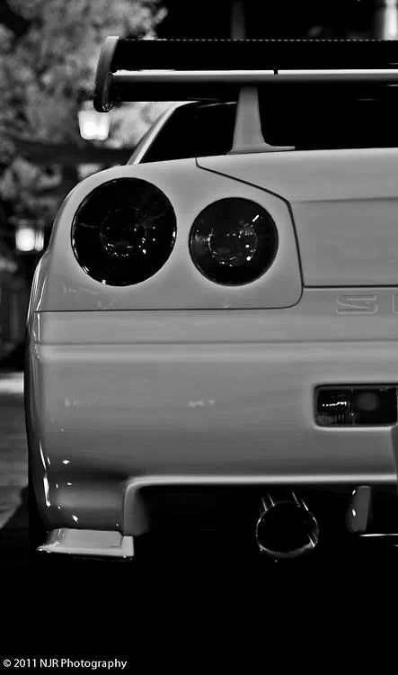 Nissan Skyline GTR R34 This is my ultimate dream car, blue/black/metallic gray with black n chrome rims and red highlights and LED lights