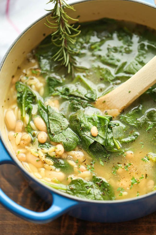 Spinach and White Bean Soup - 1 tablespoon olive oil 3 cloves garlic, minced 1 onion, diced 1/2 teaspoon dried thyme 1/2 teaspoon dried basil 4 cups vegetable stock 2 bay leaves 1 cup uncooked orzo pasta 2 cups baby spinach 1 (15-ounce) can cannellini beans, drained and rinsed Juice of 1 lemon 2 tablespoons chopped fresh parsley leaves Kosher salt and freshly ground black pepper, to taste
