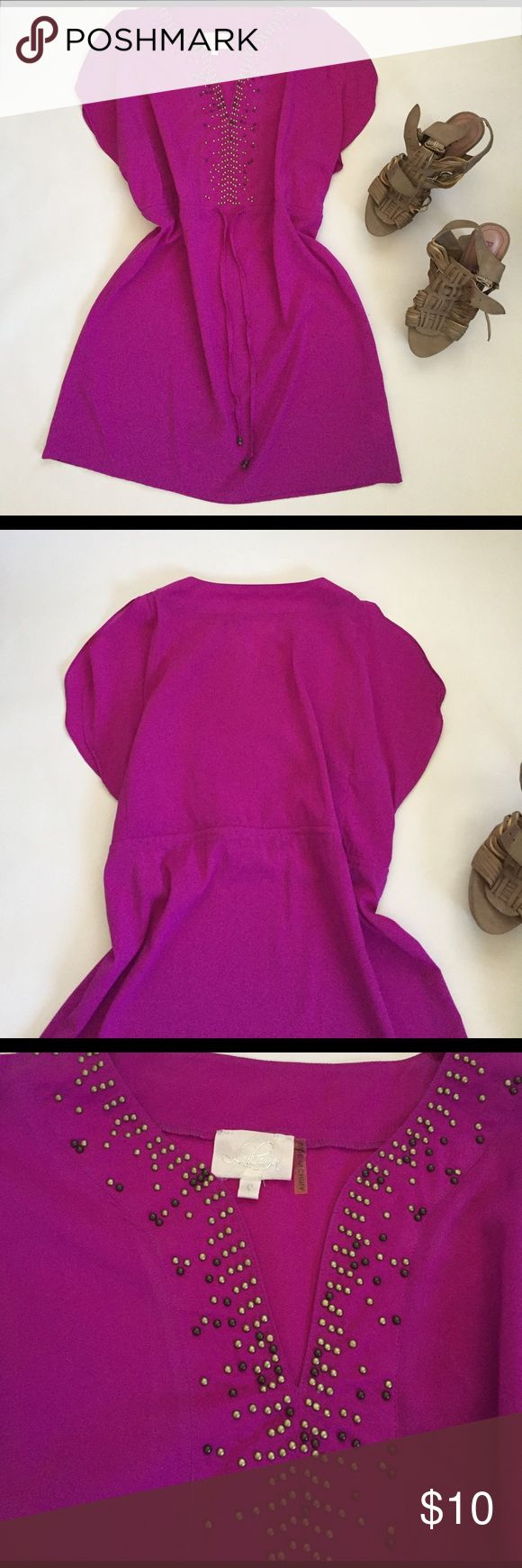 Fun purple dress I'm obsessed with the color of this dress! It's a beautiful magenta purple that looks amazing with a summer tan. Throw it on over your bikini and you have a perfect going out dress! Draw string waist, with flirty neck and sleeves. Well loved with a lot of wear left. Some beading on neck is missing, but barely noticeable Dresses