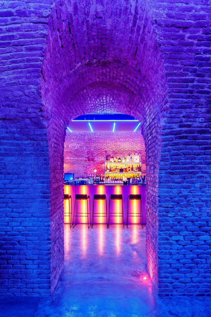 cavernous, glowing 'bala perdida club' is hidden beneath streets of madrid