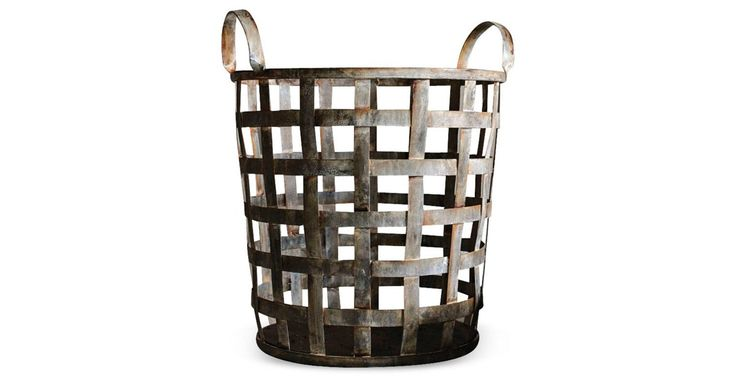 A rust finish gives a vintage look to this minimalist-chic metal basket. The handles make it especially useful for holding everything from guest towels to fireplace tools to umbrellas.