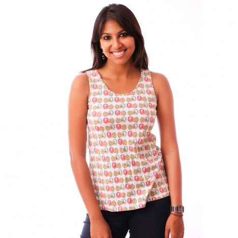 This tank top with its casual curve and scooped neck is a must have in your summer wardrobe. To buy this visit http://www.chumbak.com/apparel/tshirts-tops/peacock-women-white-tank-top.html