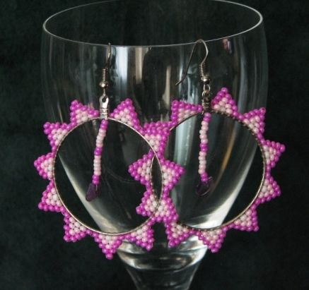 """Pretty Pink Stars to rock your big hoops, about 2.5"""" in diameter. Made with glass two-cut seed beads and real amethyst stone. $30. By Sister Bear Designs."""