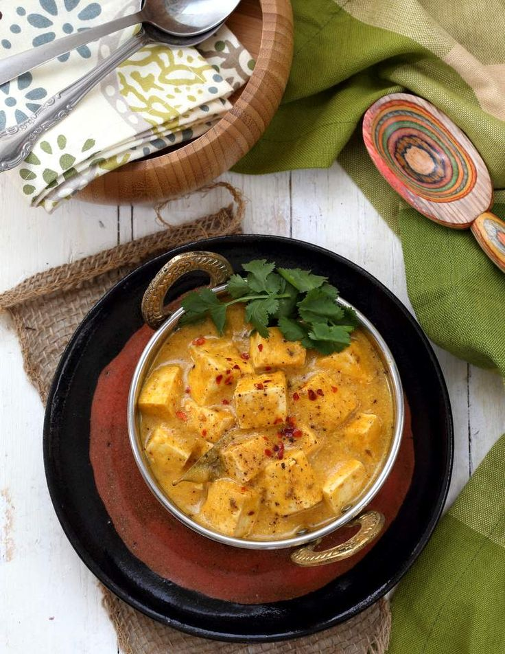 Vegan Mango Curry Tofu. Tofu crisped in Indian spices and cooked in a sauce of onions, spices and ripe mango puree! Dairy-free, Gluten-free. Use Chickpeas or veggies to make soy-free