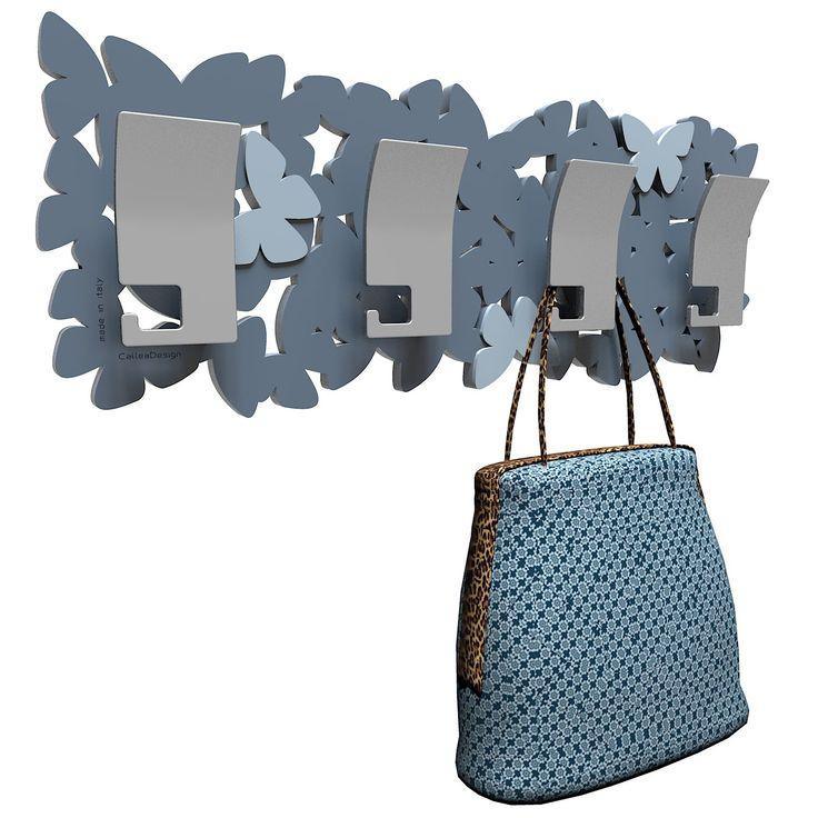 Diseñado por CalleaDesign. Estructura en madera DM a elegir entre variedad de colores. ¡Una nube de mariposas!