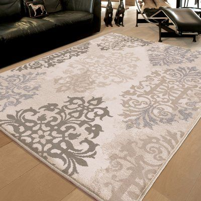<p>Lay out the foundation for a beautiful, traditional ensemble in your home with this gorgeous area rug by Three Posts.</p><p> Covered in an artistic medallion design in ivory and complementing neutral hues, this gorgeous polypropylene rug made in the USA instantly adds pattern, dimension, and warmth to any space.</p><p> Roll it out in your classic kitchen ensemble to elevate a bistro dining set, and then complement it with earthy accents and faux flor...