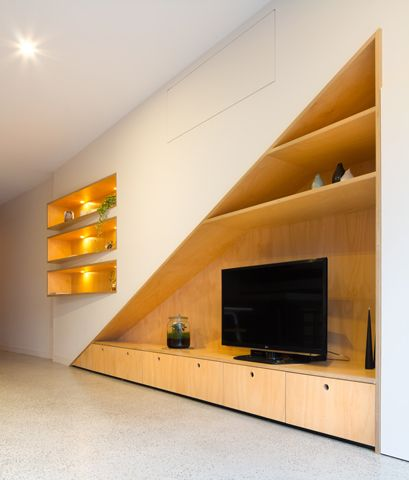 Tv and storage could work under stairs house stuff for Stair cabinet design