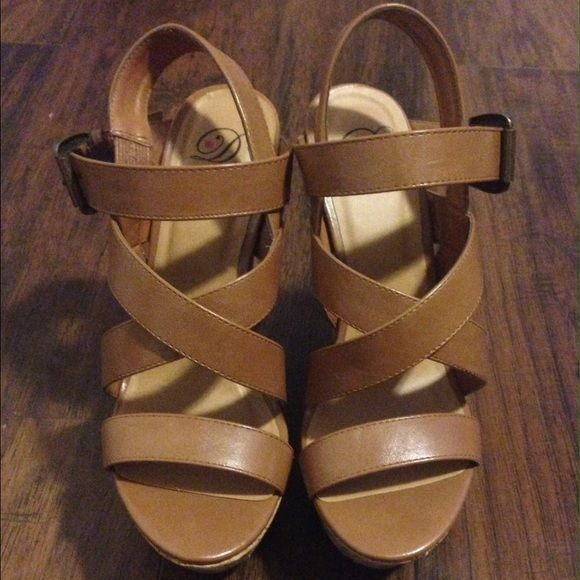 Like new tan wedges Beautiful tan wedges that were wore only once! Six inch wedge with a two inch platform. Extremely comfortable! Tilly's Shoes Wedges