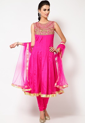 Magenta coloured Anarkali suit set for women from Sangria. Made from net, this suit set comprises a sleeveless Anarkali kameez, featuring a round neck, regular fit, knee length, a dupatta and churidar. Flaunt your classy ethnic style statement when heading for your friend's reception party with this amazingly designed, magenta coloured Anarkali suit set from the house of Sangria. Featuring a gorgeously designed round neckline, the Anarkali kameez is the highlight of this suit set.