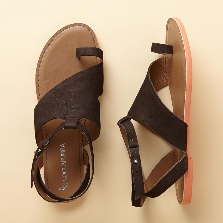 SIDEWISE SANDALS -- Chic and comfy, sleek asymmetric sandals wrap your foot securely, fastening with an adjustable brass collar stud. Imported. Coffee in nubuck or nude in leather. Whole sizes 6 to 11.