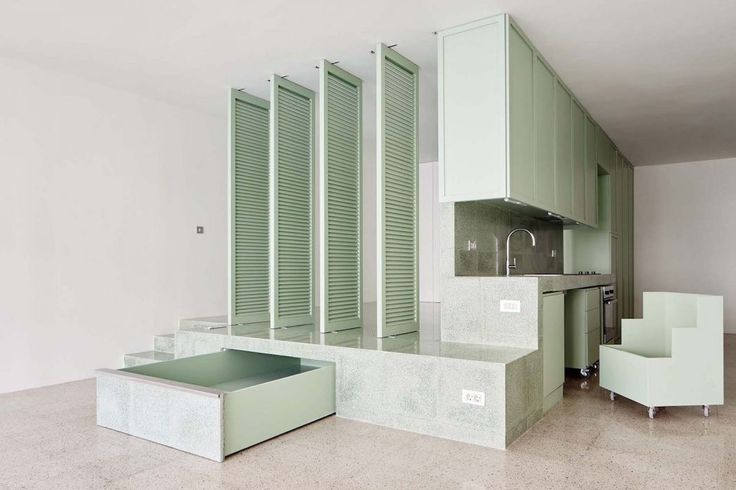 Barcelona-based architecture practice ARQUITECTURA-G refurbished the interior of a live-in photo studio, prioritising privacy and ample storage space.