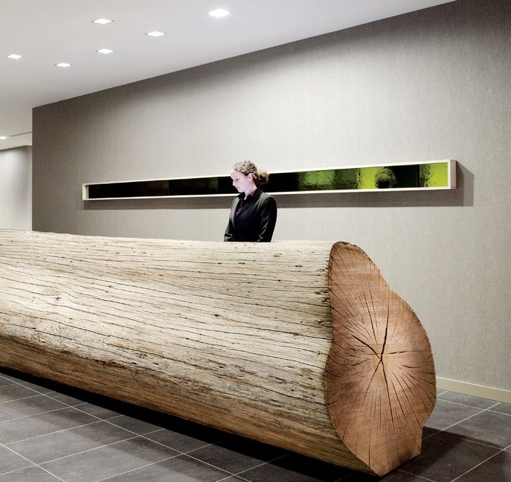 This hotel designs a modern reception area by transforming a 25-foot-long, naturally weathered eucalyptus log into a reception desk. Description from pinterest.com. I searched for this on bing.com/images