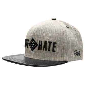 Me pongo esta gorra en mi tiempo libre. Ésta es gris y negro. También, está de…