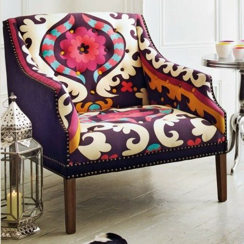 Very cool arm chair. Great textiles. Love the purple. Looks comfortable, too.