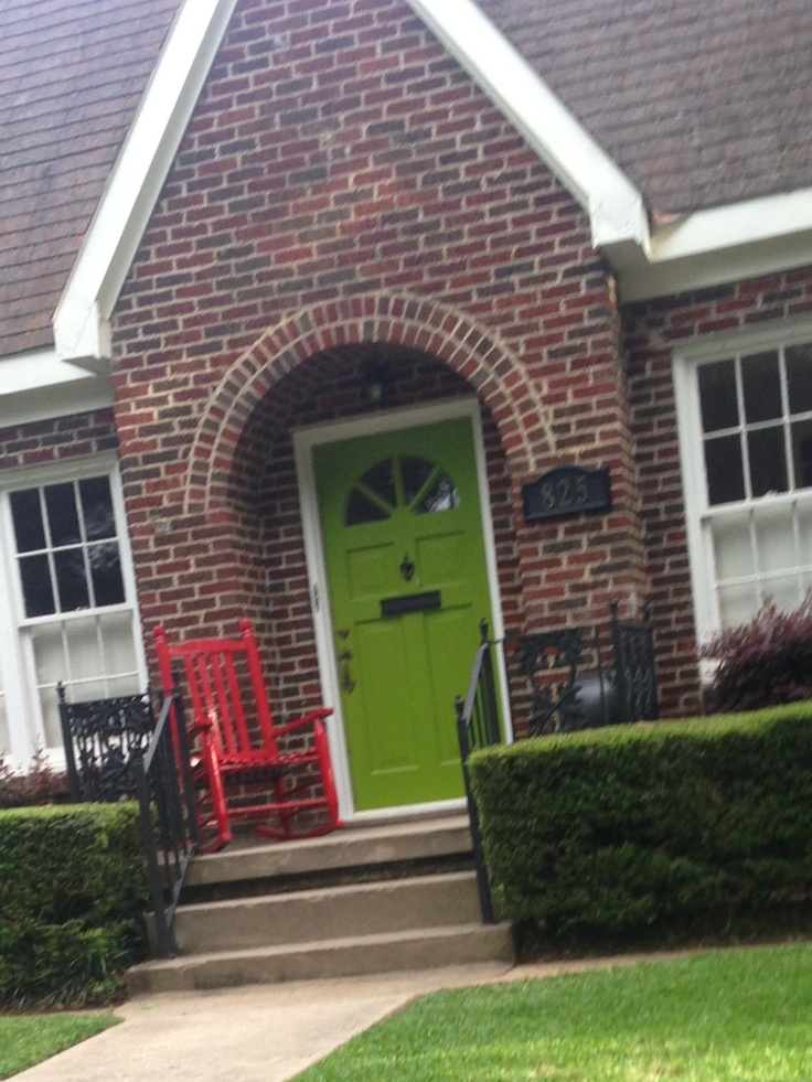 Lime green front door! This is so pretty, especially with the red rocking chair!