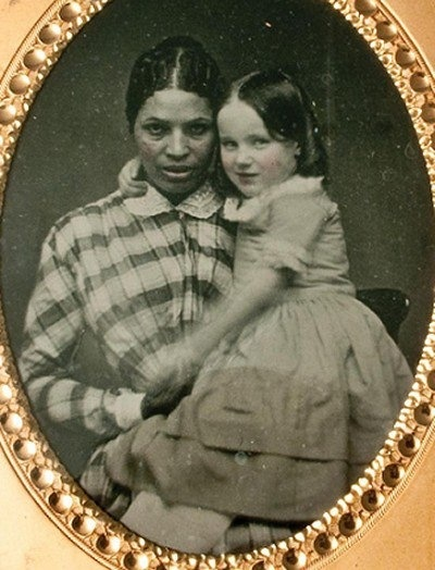 "Pre-Civil War Slave in Baltimore. Martha Ann ""Patty"" Atavis holds Alice Lee Withridge (one of the children in her care)."