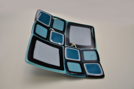 "Decorative handmade plate ""Tortuga"" performed by myself in my glass workshop. Plate was done from Baoli fusable glass in the glass kiln.  It has practical but decorative form combining several colours and shapes. Combine mosaic of stacked squares in cyan, blue, black and white colour. As it's a handmade item it has several natural inconsistencies in the structure - makes plate even more natural and beautiful."