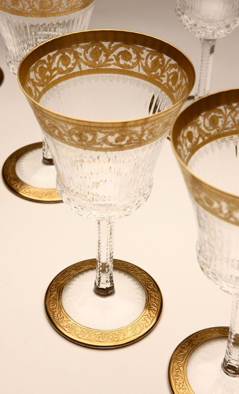 Lot# 1096 A set of eight St. Louis 'Thistle Gold' gilt clear glass wine goblets. 20th Century, marked ''Cristal / St. Louis / France'', with foliate guilloche band to rim, 8 pcs, 6.25'' H x 3.25'''' Dia., est: $600/800 *Price Realized: $2,205.00