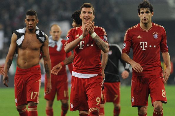 Mario Mandìukic (C) of FC Bayern Muenchen celebrates victory at the end of the UEFA Champions League quarter-final second leg match between Juventus and FC Bayern Muenchen at Juventus Arena on April 10, 2013 in Turin, Italy.