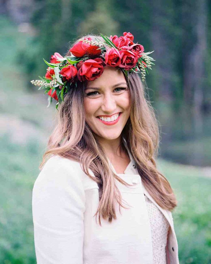 54 Flower Crown Ideas to Top Off Your Wedding Hairstyle   Martha Stewart Weddings - Love flower crowns but not sure if you want to commit to wearing one on the big day? Take a cue from this bride and don it for the rehearsal dinner. Hers was a collection of hot cocoa garden roses, grevillea, scabiosa, jasmine, and echinacea pods.