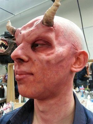 Kristyan Mallett. Horned makeup on student at Bolton University.