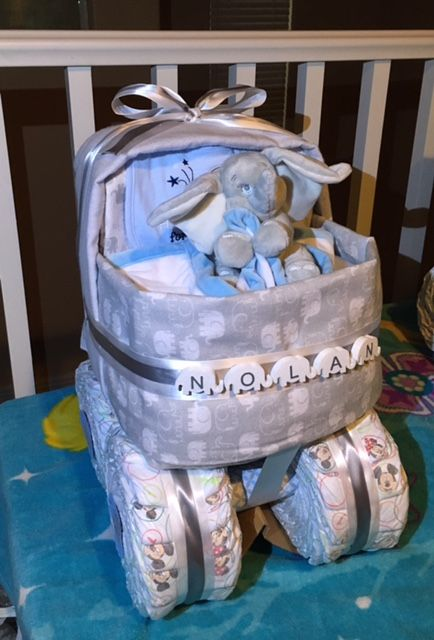 Elephant bassinet diaper cake. Super cute and fun to make.
