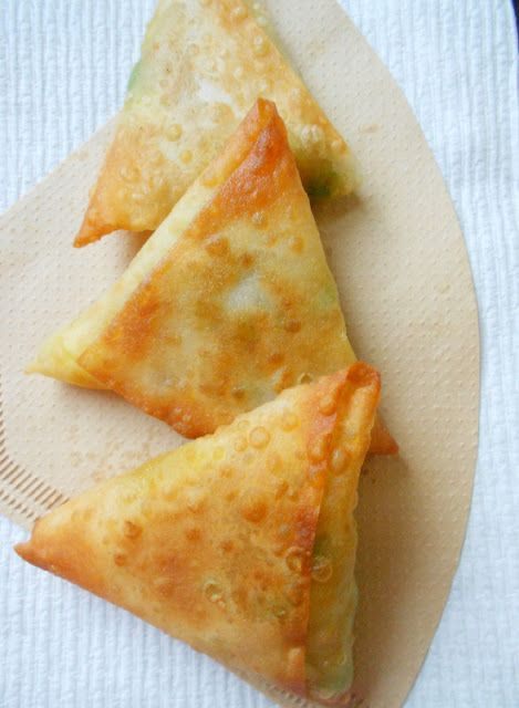 These Potato Samosas had us at 'Potato' :) 2 large potatoes (boiled, peeled, and mashed) 1/2 teaspoon ground cumin 1/2 teaspoon ground ginger 1/2 teaspoon turmeric powder 1/2 teaspoon garam masala powder (combo of cumin, coriander, black pepper, cinnamon, and nutmeg) heaping 1/4 teaspoon cayenne pepper powder 1/2 teaspoon coriander powder 1/4 teaspoon lemon juice 1/2 cup frozen green peas (steamed for 5 minutes) salt to taste 1 tablespoon vegetable oil- 1 pack of samosa pastry sheets