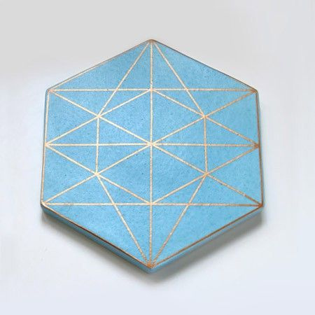 From Xenia Taler's latest tile/trivet line. I love all of the copper and gold detailing and the geometric shapes... and I really REALLY love this blue!