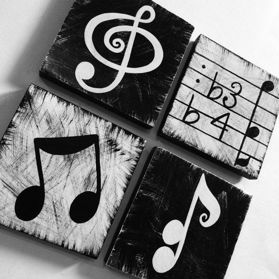 You will fall in love with these bold, black & white hand painted music symbols!  -set of 4 -measures 5&1/2 x 5&1/2 -4 different designs -black & white -sealed with gloss -hang on wall, stack on shelves, these are so versatile, they could be placed in family room, or just as easily decorate a childs room, &/or a place of music