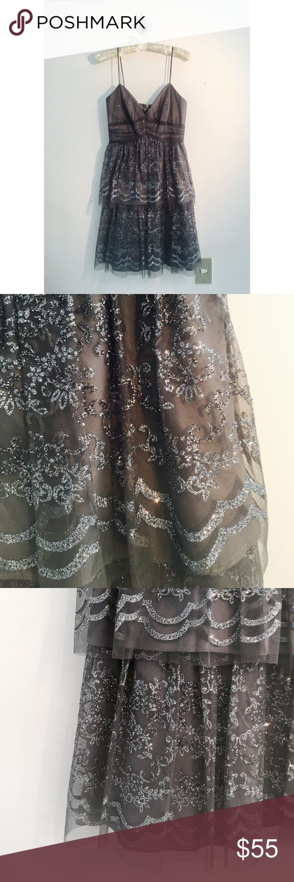 Glitter Mini Gray Dress A gorgeous, glittery mini luxe dress in a beautiful gray color. Tiered tulle skirt with silver sparkle pattern. Perfect for a formal event or a night out. Fits like a 0. Zum Zum by Niki Livas Dresses Mini