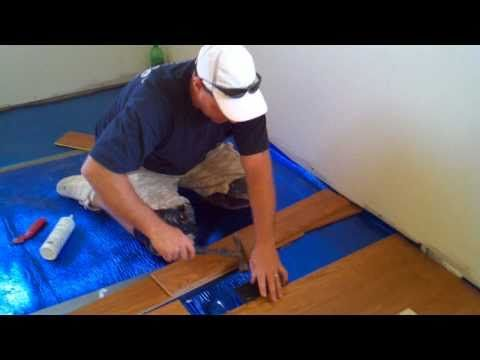 How To Install A Floating Hardwood Floor - this guy makes it look pretty darn easy.