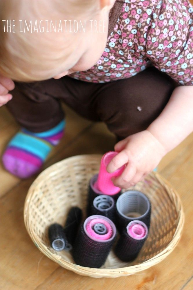 Baby sensory play activity with hair rollers (nesting, building, etc.)